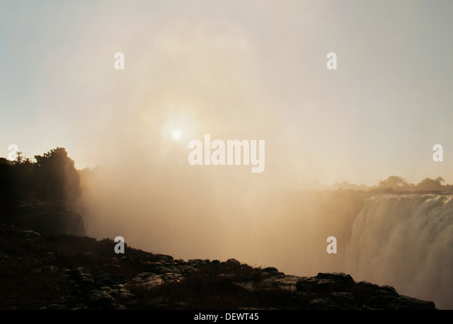 Victoria Falls at sunset, Zimbabwe, Zambezi River - Stock Image