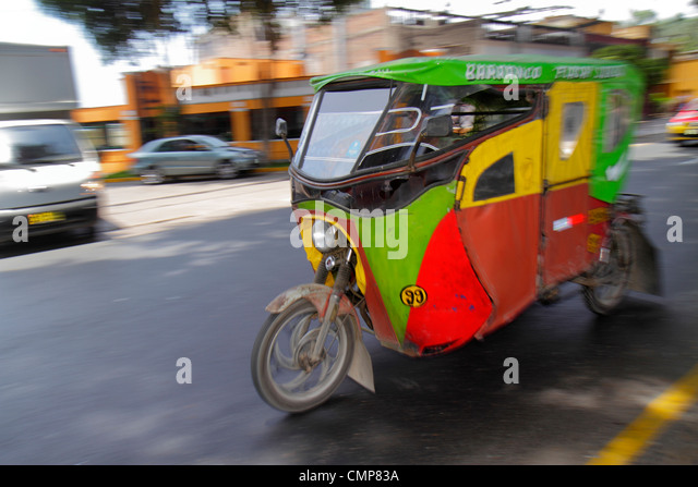Peru Lima Barranco District Avenida Pedro D'Osmo street scene motion moving alternative transport motorcycle - Stock Image