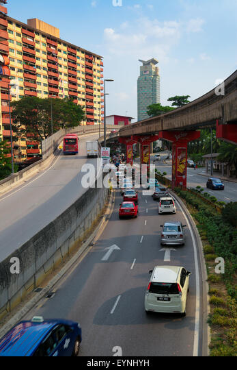Road and bridges near a residential apartment in Kuala Lumpur, Malaysia. Concept of noise pollution at housing area. - Stock Image