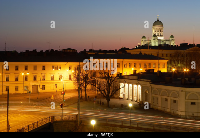 Helsinki skyline and Cathedral at dusk Presidential Palace and Guard Post illuminated in foreground Helsinki Finland - Stock Image