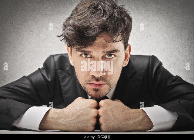 Portrait of a determined young businessman - Stock Image
