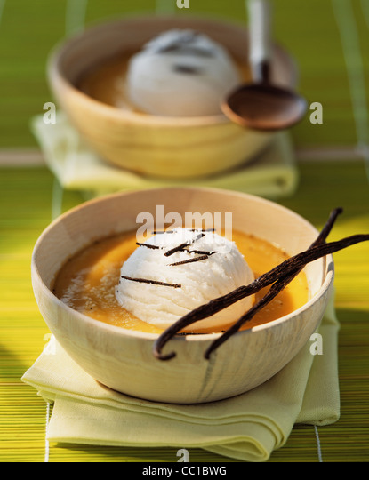 Pumpkin soup with coconut ice cream - Stock Image