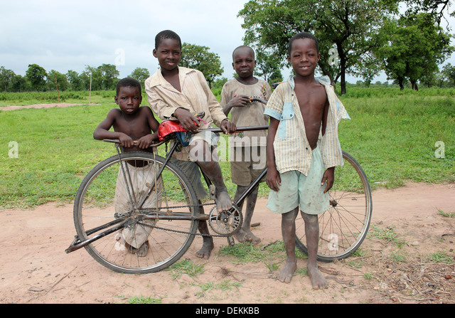 Ghanaian Boys Of The Gonja Ethnic Group With Bicycle - Stock Image