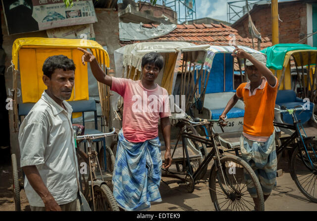 Rickshaw drivers in Tamluk, West Bengal. - Stock Image