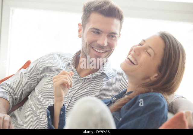 Couple spending lighthearted time together at home - Stock Image