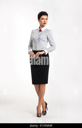Confident entrepreneur woman in business suit - fashion skirt and blouse - Stock Image