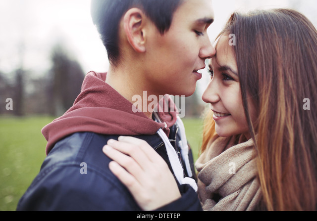 Close up image of cute young couple in love together in park. Asian teenage couple spending romantic time with each - Stock-Bilder