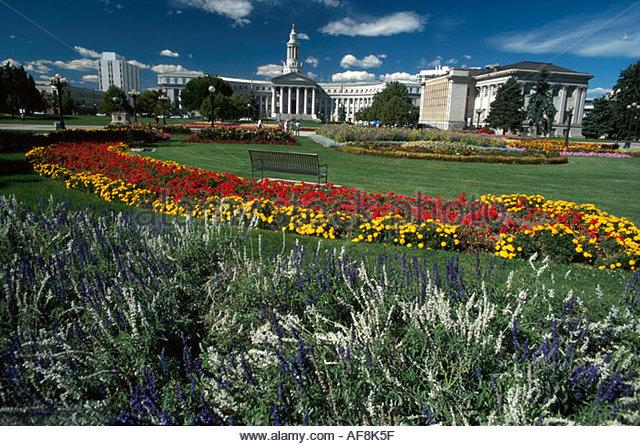 Colorado Denver Civic Center Park flower garden City & County Building beyond - Stock Image