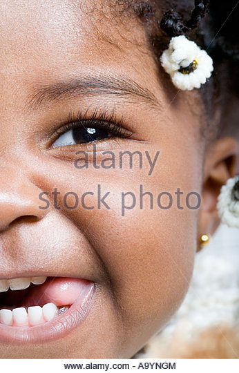 Baby girl sticking tongue out - Stock Image