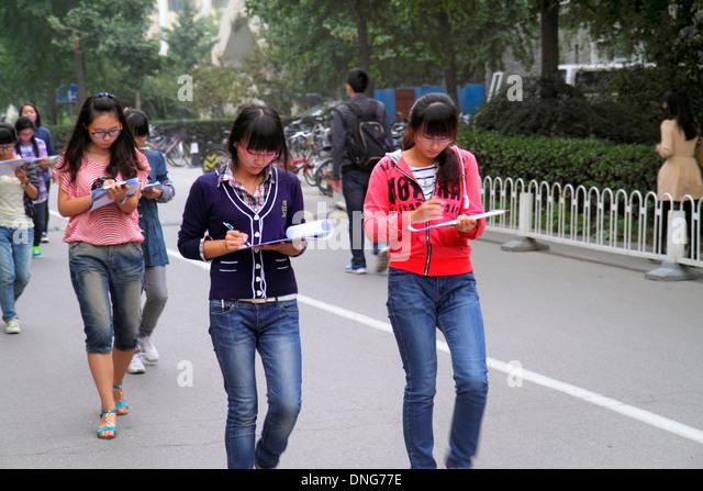 Beijing China Haidian District Peking University PKU Beidà higher education campus Asian woman friends teen - Stock Image