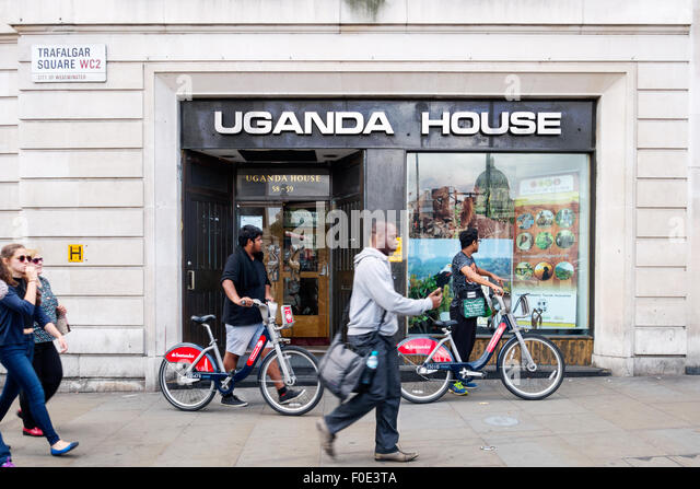 People outside Uganda House, the Uganda High Commission, Trafalgar Square, London UK - Stock Image