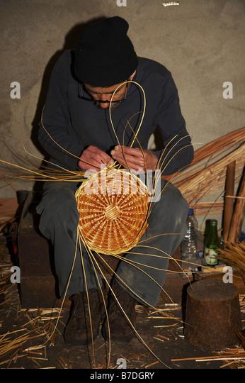 basket maker, Portugal, Madeira, Camacha - Stock Image