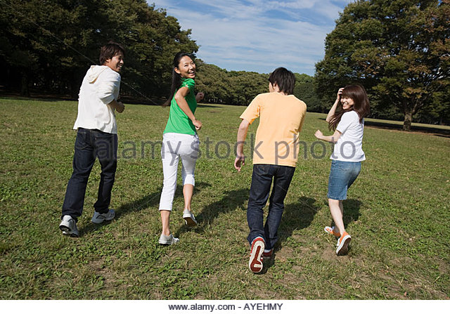 Friends having fun in park - Stock Image