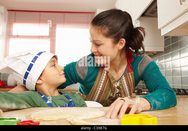 Mother and son having fun in kitchen - Stock Image