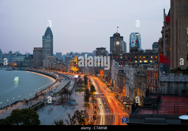 View along the Bund at night, Shanghai, China - Stock Image