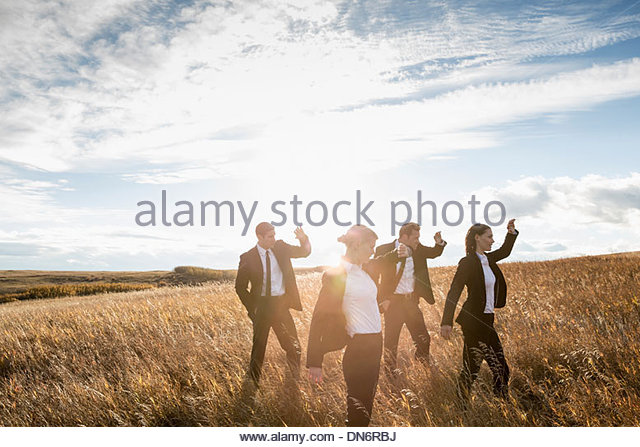 Business people battling against wind outdoors - Stock Image