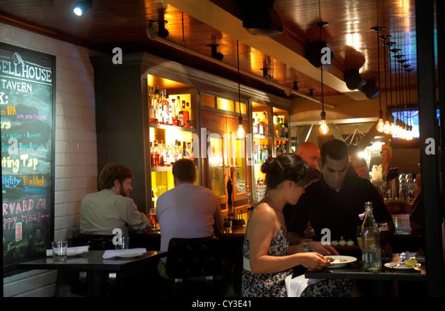 Boston Massachusetts Cambridge Harvard Square Russell House Tavern restaurant bar man woman couple waiter night - Stock Image