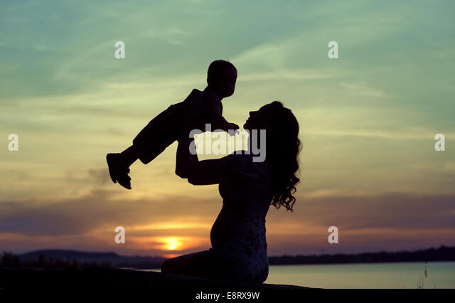 Pregnant mother playing with her lovely child - Stock Image