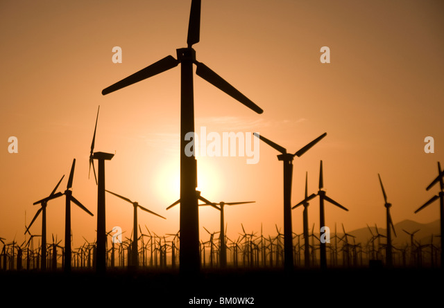 Windmill farm at sunset in Palm Springs Coachella Valley Southern California USA - Stock Image