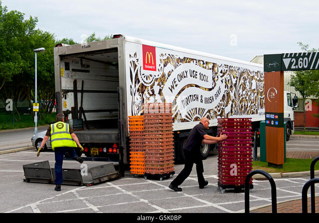 Men delivering to a branch of McDonalds, England UK - Stock Image
