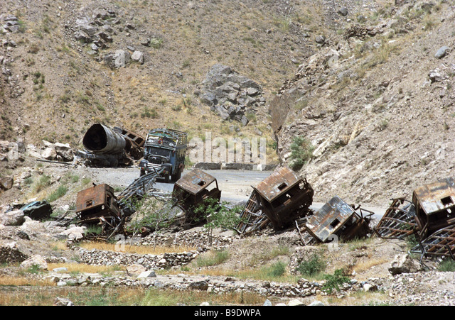 Remains of the truck column destroyed by the Afghan moujahedin on the Salang mountain pass - Stock Image