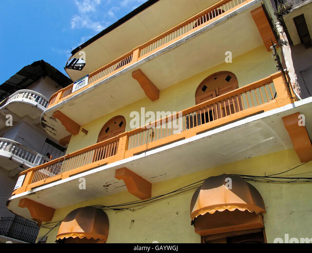 Beige and orange preserved and refurbished building featuring old classic architecture in Casco Viejo, Panama. - Stock Image
