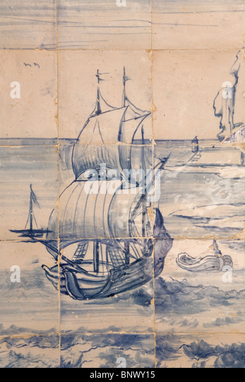 Azulejo tiles depict a scene of Portuguese seafaring and discovery in Lisbon, Portugal. - Stock Image
