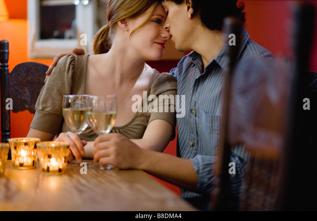 Romantic couple in a bar - Stock-Bilder