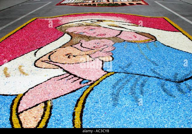 Street of flowers (Infiorata) at Castelraimondo, in celebration of Corpus Christi/Corpus Domini,Le Marche Italy - Stock Image