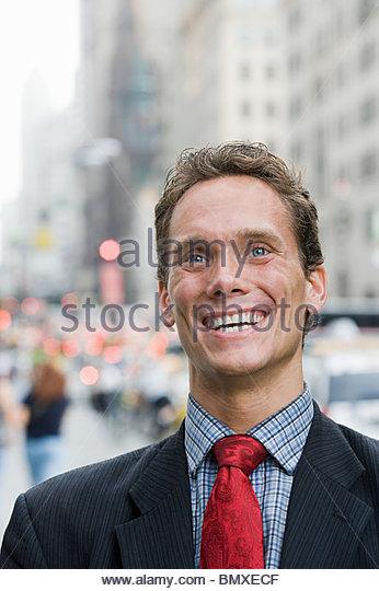 Portrait of businessman in street - Stock Image