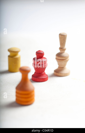 antique game pieces or markers on white - Stock Image