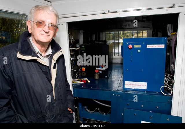 Professor Rex Harris who developed the boat is infront of the fuel cells and hydride cylinders - Stock Image