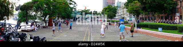 early morning badminton ; Riverfront downtown; Ho Chi Minh City; Vietnam - Stock Image