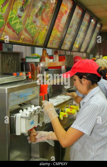 Santiago Chile Bellavista Pio Nono Doggis hot dogs fast food restaurant business franchise counter Spanish branding - Stock Image