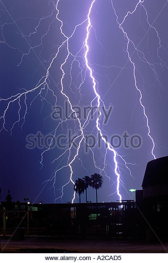 Big lightning bolts at the University of Arizona the side of McKale Center can be seen on the right - Stock Image