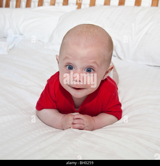 Baby boy in a red teeshirt, London,England - Stock Image