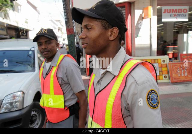 Santo Domingo Dominican Republic Ciudad Colonia Calle el Conde Peatonal pedestrian mall Hispanic Black policeman - Stock Image