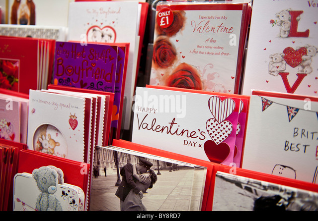 Racks of valentine day cards on sale at a branch of W H Smith, UK - Stock Image