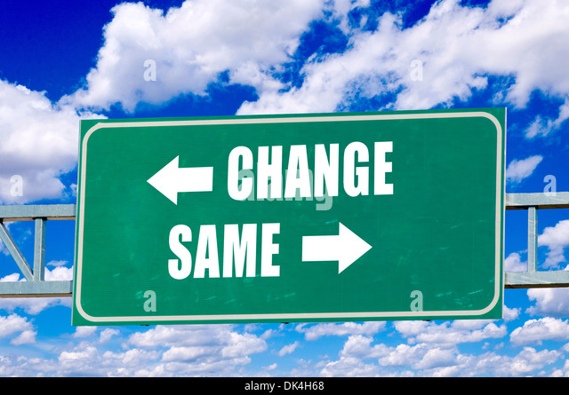 Change and same sign on the green board with clouds in background - Stock-Bilder