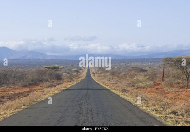 Straight road leading into Kenya in Southern Ethiopia, Africa - Stock Image