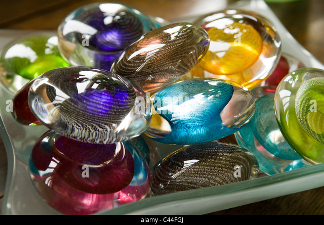 Detail of assorted coloured glass pebbles - Stock Image