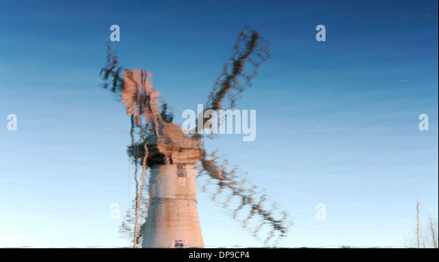 A reversed reflection of Thurne Dyke Drainage Mill on the Norfolk Broads at Thurne, Norfolk, England, United Kingdom. - Stock Image