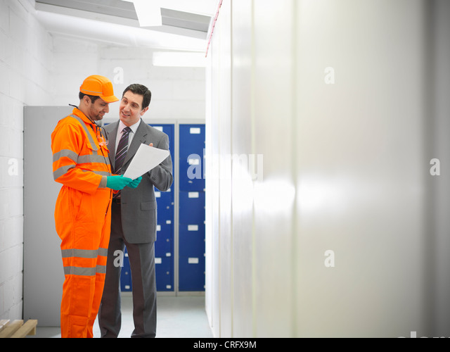 Apprentice engineer with businessman - Stock Image