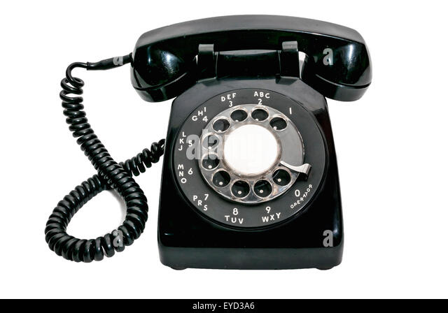 Classic black rotary dial telephone isolated on white - Stock Image