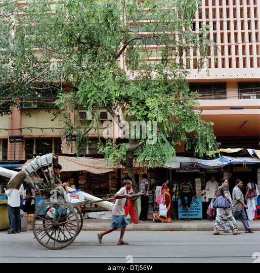 A rickshaw being pulled in Calcutta (Kolkata) in West Bengal in India. - Stock Image