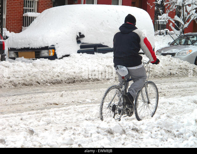 cyclist-riding-bike-in-deep-snow-on-road