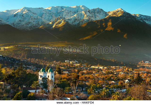 Los Dominicos Church in Pueblito Los Dominicos with Andes Mountains in the background, Santiago de Chile, Chile - Stock Image