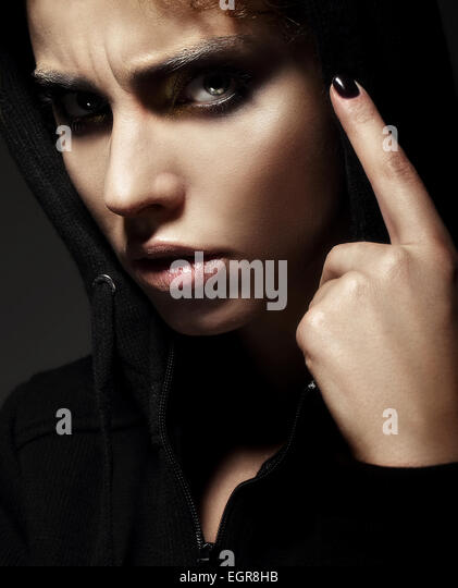 Closeup Portrait of Strict Young Woman - Stock Image