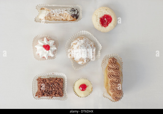 A selection of party desserts, organic food, and dainty cakes and pastries. - Stock Image