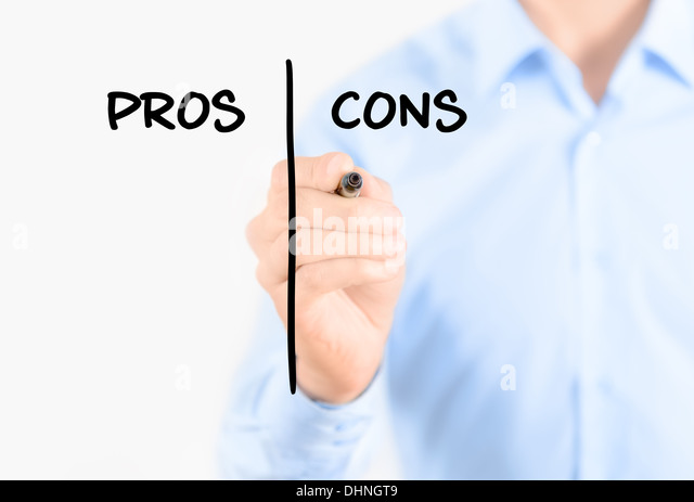 Young businessman holding a marker and writing pros and cons comparison concept for weigh all arguments - Stock Image